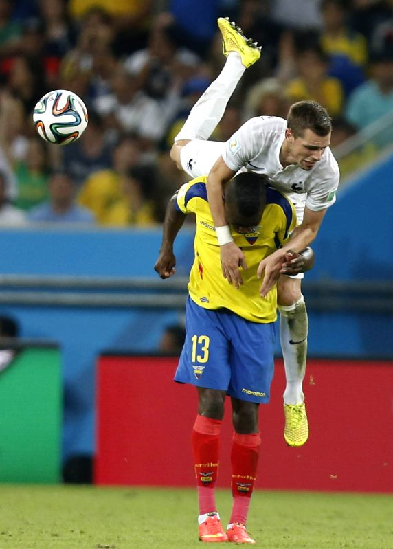 Ecuador's Enner Valencia vies for the ball during a Group E match between Ecuador and France of 2014 FIFA World Cup at the Estadio do Maracana Stadium in Rio