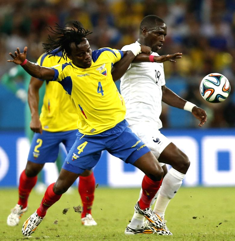 Ecuador's Juan Carlos Paredes vies for the ball with France's Moussa Sissoko during a Group E match between Ecuador and France of 2014 FIFA World Cup at the .