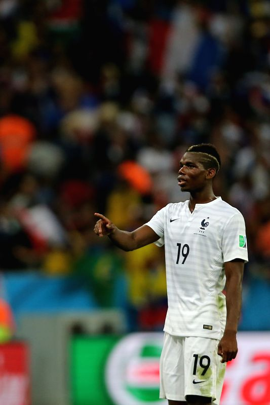 France's Paul Pogba reacts during a Group E match between Ecuador and France of 2014 FIFA World Cup at the Estadio do Maracana Stadium in Rio de Janeiro, ...