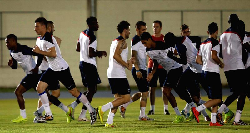 Players of France's national soccer team take part in a training session in Rio de Janeiro, Brazil, on June 24, 2014. France will play with Ecuador on ...