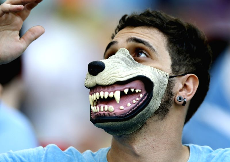 A supporter of Uruguay is seen before a Round of 16 match between Colombia and Uruguay of 2014 FIFA World Cup at the Estadio do Maracana Stadium in Rio de ...
