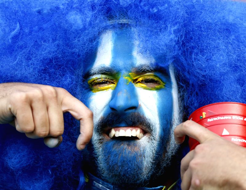 A supporter of Uruguay poses before a Round of 16 match between Colombia and Uruguay of 2014 FIFA World Cup at the Estadio do Maracana Stadium in Rio de ...