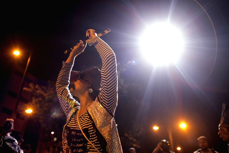 RIO DE JANEIRO June 28, 2014 An activist is seen under the spotlight of a police helicopter during a protest against FIFA World Cup outside the Estadio Maracana Stadium during a Round of .