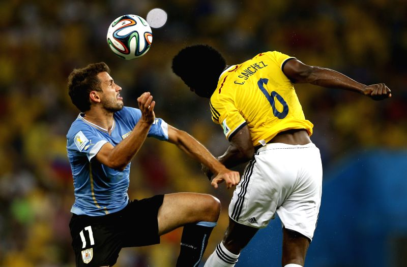 Colombia's Carlos Sanchez (R) vies with Uruguay's Cristian Stuani during a Round of 16 match between Colombia and Uruguay of 2014 FIFA World Cup at the ...