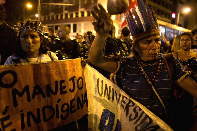 RIO DE JANEIRO June 28, 2014 People participate in a protest against FIFA World Cup outside the Estadio Maracana Stadium during a Round of 16 match between Colombia and Uruguay of 2014 ...