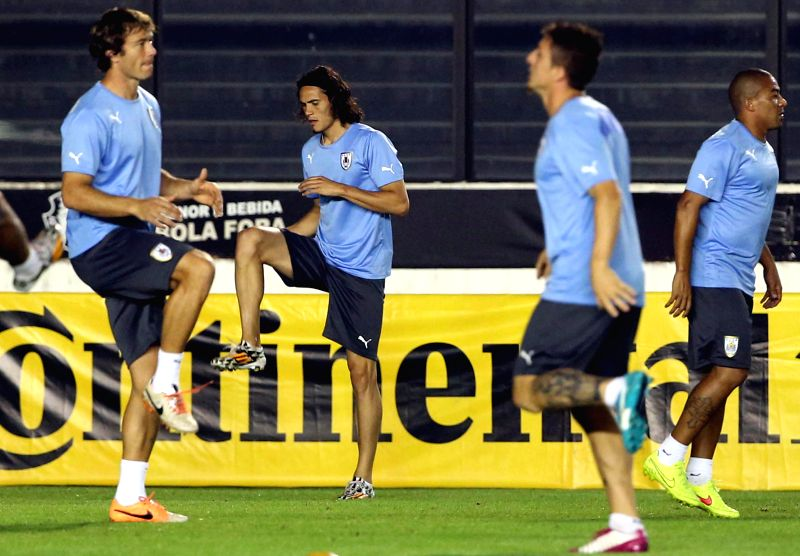 Uruguay's National Team players attend a training session in Rio de Janeiro, Brazil, on June 27, 2014. Uruguay will face Colombia next Saturday during the ...