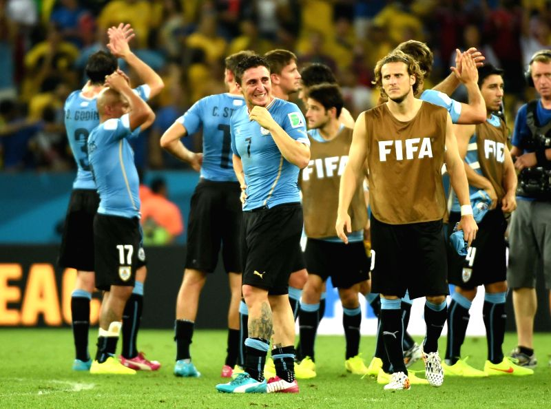 Uruguay's players react after a Round of 16 match between Colombia and Uruguay of 2014 FIFA World Cup at the Estadio do Maracana Stadium in Rio de Janeiro, ..
