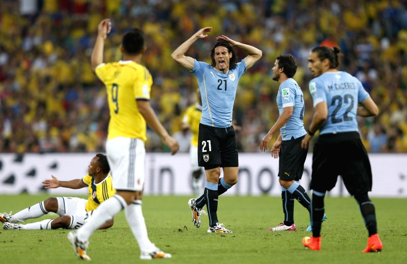 Uruguay's Edinson Cavani (C) reacts as referee calls a foul on him during a Round of 16 match between Colombia and Uruguay of 2014 FIFA World Cup at the ...