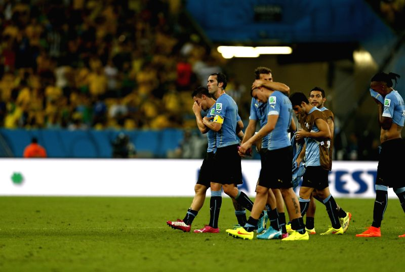 Uruguay's players leave the field after a Round of 16 match between Colombia and Uruguay of 2014 FIFA World Cup at the Estadio do Maracana Stadium in Rio de .