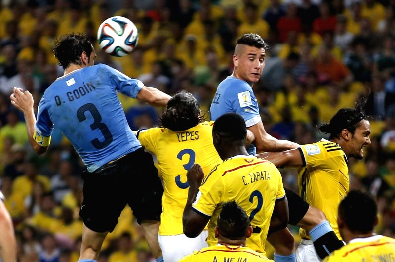 Uruguay's Diego Godin (1st L) heads the ball during a Round of 16 match between Colombia and Uruguay of 2014 FIFA World Cup at the Estadio do Maracana ...