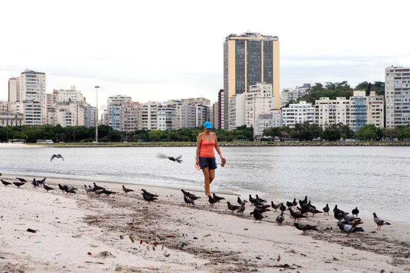 A woman walks on Botafogo beach in the polluted Guanabara Bay in Rio de Janeiro, Brazil, on March 10, 2015. The Olympic 2016 sailing competitions will be ...