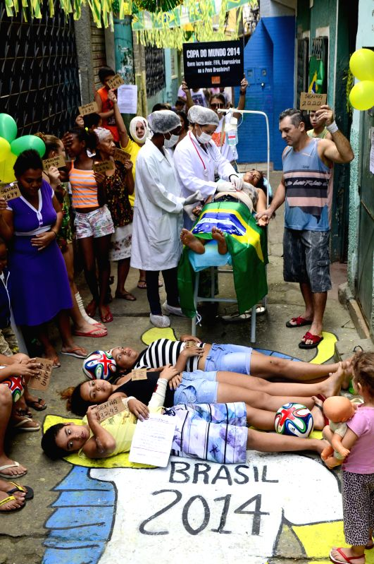 Residents participate in a protest at Jacarezinho community, in Rio de Janeiro, Brazil, on May 10, 2014. Community locals held a pacific protest emulating the