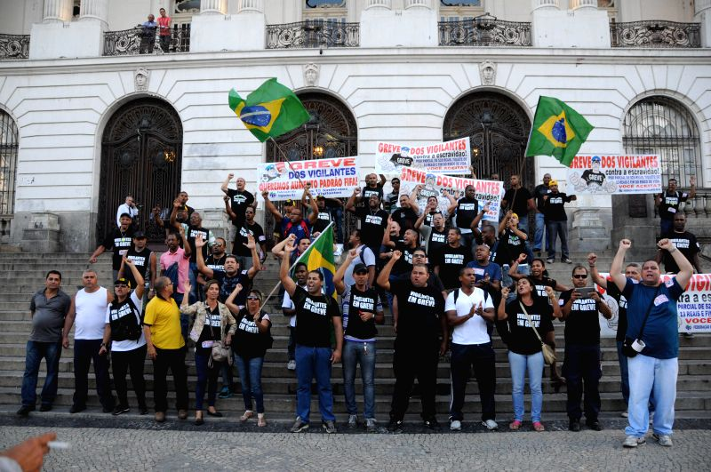 Workers participate in a strike in front of Floriano Square, in Rio de Janeiro, Brazil, on May 13, 2014. The strike is held demanding better working ...