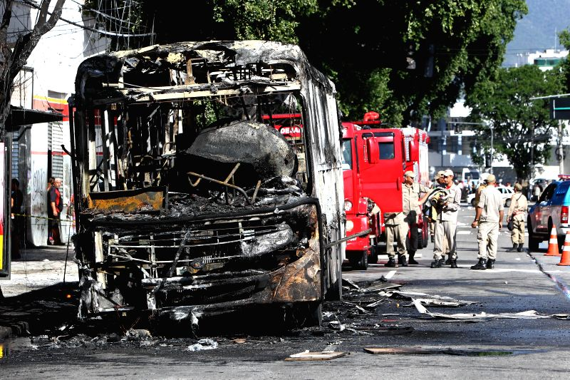 Photo taken on May 15, 2015 shows a burnt public bus in Rio de Janeiro, Brazil, on May 15, 2015. Demonstrators set two public buses on fire on Friday in the ...