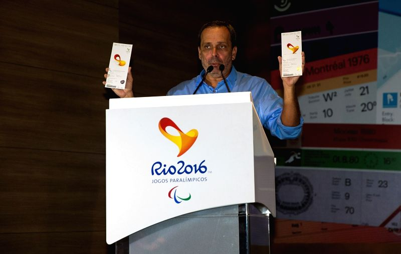 RIO DE JANEIRO, May 31, 2016 - Leonardo Caetano, director of the ceremonies of Rio 2016, shows the Paralympic ceremonies' tickets during a press conference to mark 100 days until the start of the ...