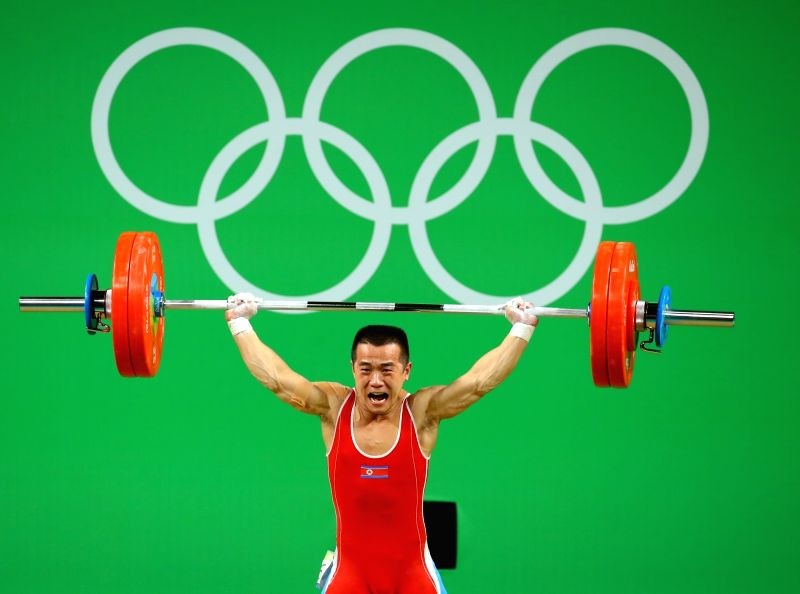 Rio de Janeiro: North Korean weightlifter Om Yun-chol lifts a barbell during the men's under-56kg weightlifting competition at the 31st Summer Olympic Games at Rio centro Pavilion 2 in Rio de Janeiro ...