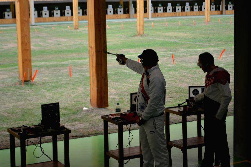 Rio de Janeiro: Prakash Nanjappa aims at the target during 50M Pistol Qualification of Rio 2016 Olympics in Rio De Janeiro, Brazil on Aug 10, 2016.