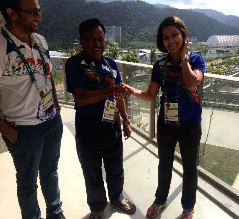 Rio De Janeiro: Shooter Heena Sidhu with husband Ronak Pandit and Chef de Mission of the Indian contingent Rakesh Gupta at the Olympic Village in Rio De Janeiro on July 31, 2016. - Rakesh Gupta
