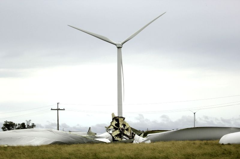 Photo taken on Dec. 21, 2014 shows the debris of a destroyed wind turbine tower as consequence of the strong winds produced by a storm at a wind farm in .