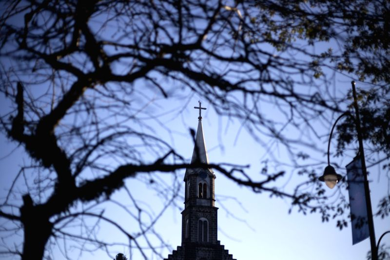 View of the tower of a church in the downtown of Gramado, in the state of Rio Grande Do Sul, Brazil, on July 2, 2014. Located in the Serra Guacha region, ..