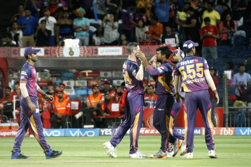 Rising Pune Supergiant celebrate after winning an IPL 2017 match between Rising Pune Supergiant and Royal Challengers Bangalore at Maharashtra Cricket Association Stadium in Pune on April 29, ...