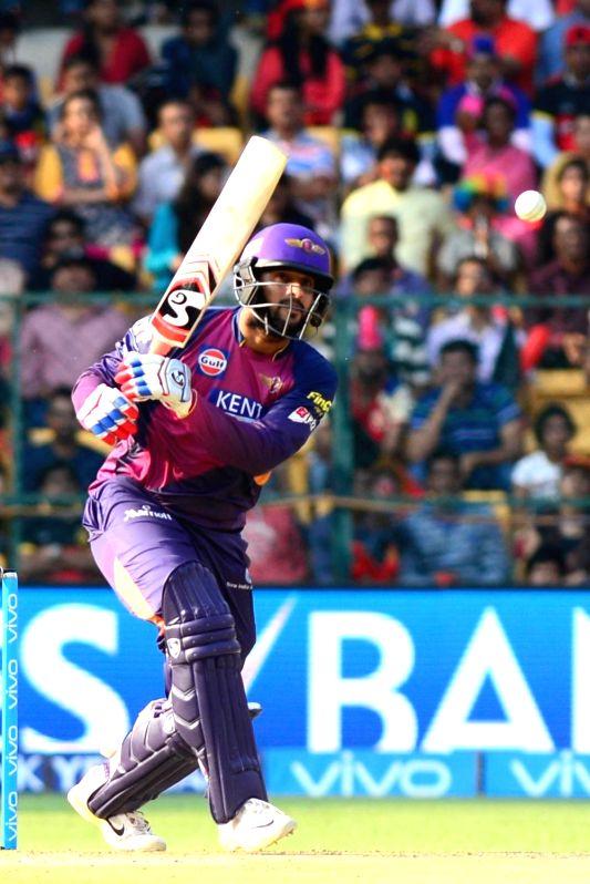 Rising Pune Supergiants batsman Saurabh Tiwar in action during an IPL match between Royal Challengers Bangalore and Rising Pune Supergiants at M Chinnaswamy Stadium in Bengaluru on May 7, ... - Saurabh Tiwar