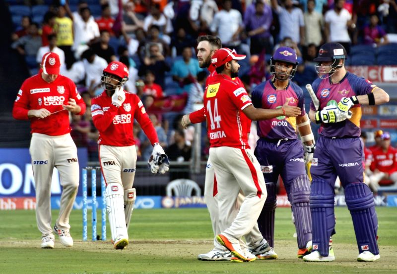 Rising Pune Supergiants celebrate after winning an IPL 2017 match between Rising Pune Supergiant and Kings XI Punjab at Maharashtra Cricket Association Stadium in Pune on May 14, 2017.