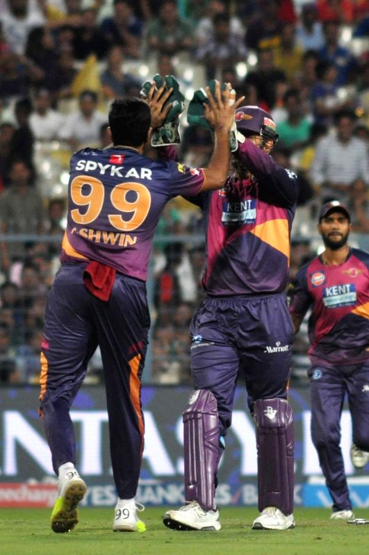 Rising Pune Supergiants celebrate fall of a wicket during an IPL match between Kolkata Knight Riders and Rising Pune Supergiants at Eden Gardens in Kolkata on May 14, 2016.