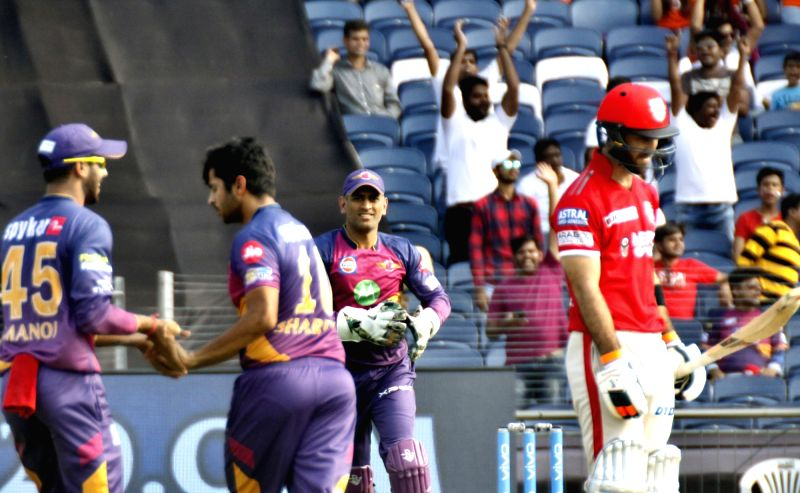 Rising Pune Supergiants celebrate fall of a wicket  during an IPL 2017 match between Rising Pune Supergiant and Kings XI Punjab at Maharashtra Cricket Association Stadium in Pune on May 14, ...