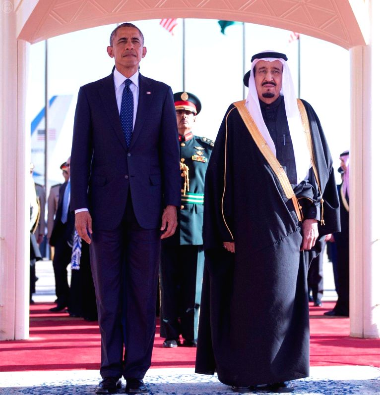 Saudi Arabia's King Salman bin Abdulaziz Al Saud(R) holds a welcoming ceremony for U.S. President Barack Obama in Riyadh, Saudi Arabia, on Jan. 27, 2015. Obama cut ..