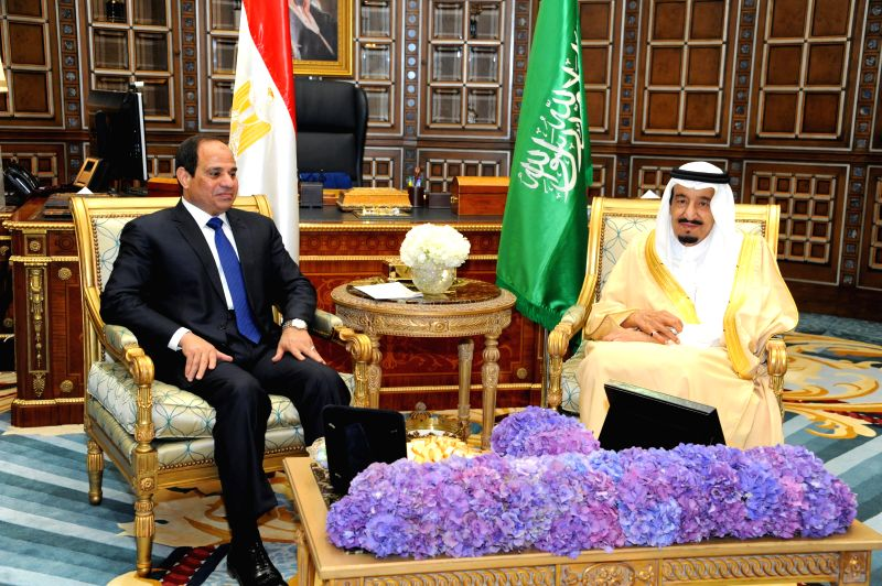 The handout photo from Egypt's state-run news agency MENA shows that Saudi Arabia's King Salman (R) meets the visiting Egypt's President Abdel Fattah al-Sisi in ...