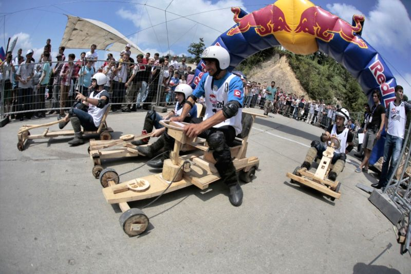 Players drive the wood wheeled racing cars during the game in Rize of Turkey, on Aug. 17, 2014. An interesting game of wood wheeled racing cars was held in Ardesen of .