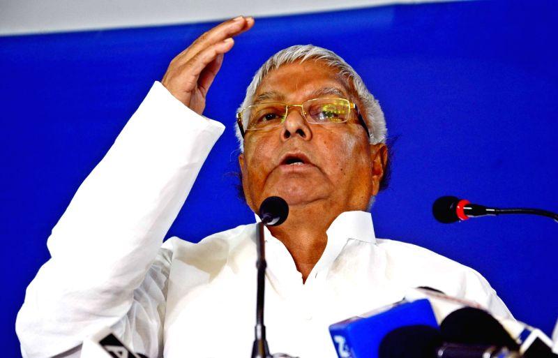 RJD chief Lalu Prasad Yadav addresses a press conference in Patna, on Nov 13, 2015.