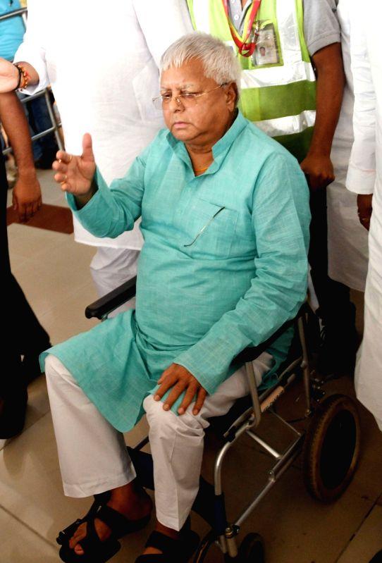 RJD chief Lalu Prasad Yadav arrives at Jay Prakash Narayan Airport after undergoing treatment in Mumbai; in Patna on June 4, 2018. - Lalu Prasad Yadav