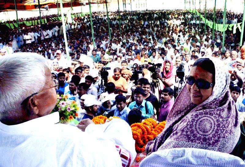 RJD chief Lalu Prasad Yadav campaigning for his wife and former Bihar Chief Minister Rabri Devi at Chhapra, Bihar on April 12, 2014. - Rabri Devi