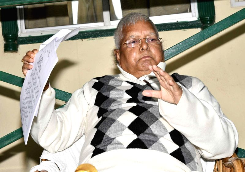 RJD chief Lalu Yadav addresses a press conference in Patna, on Dec 15, 2017. - Lalu Yadav