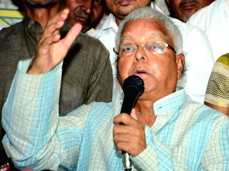 RJD leader Lalu Prasad Yadav addresses a press conference in Patna, on Oct 27, 2015. - Lalu Prasad Yadav