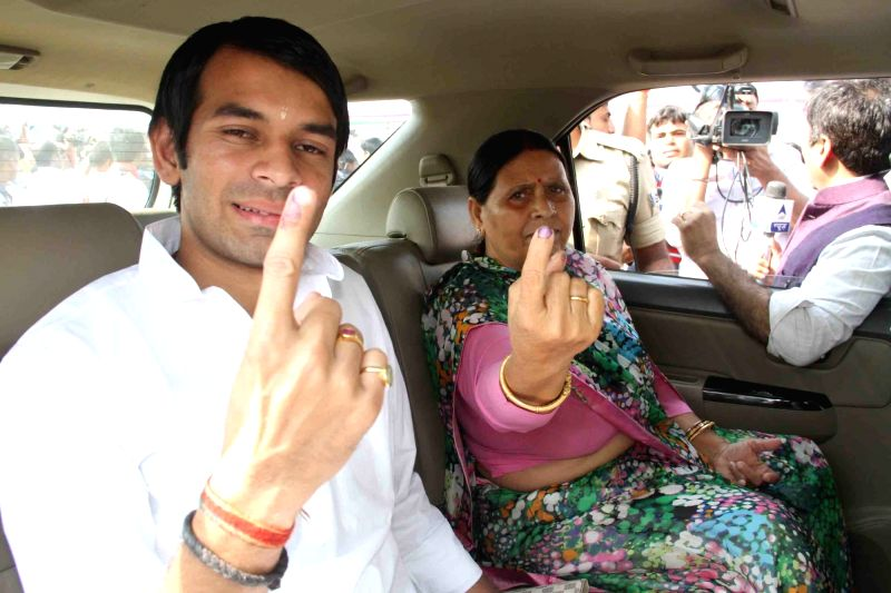 RJD leader Rabri Devi and her son Tej Pratap Yadav show their fore fingers marked with phosphorous ink after casting their vote during the third phase of Bihar assembly polls in Patna on Oct ... - Tej Pratap Yadav