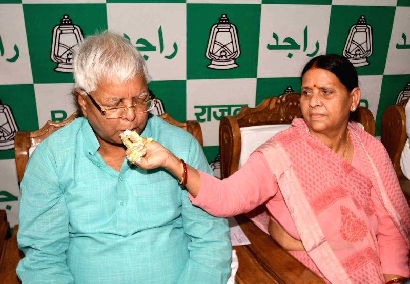RJD leader Rabri Devi greets party supremo and her husband Lalu Prasad Yadav on his birthday in Patna on June 11, 2017. - Lalu Prasad Yadav