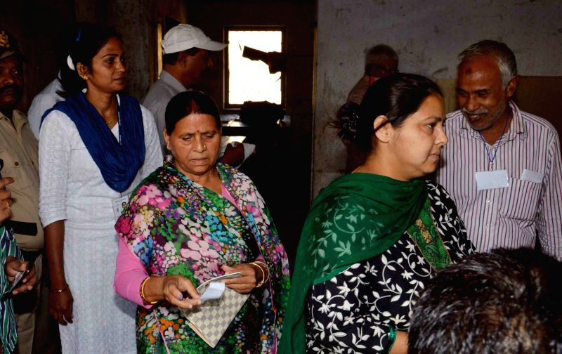 RJD leader Rabri Devi with her daughter Misa Bharti arrive to cast their vote during the third phase of Bihar assembly polls in Patna on Oct 28, 2015.