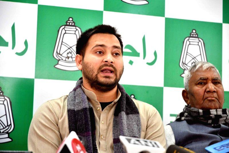 RJD leader Tejashwi Yadav addresses a press conference at his residence in Patna on Feb 1, 2018. - Tejashwi Yadav