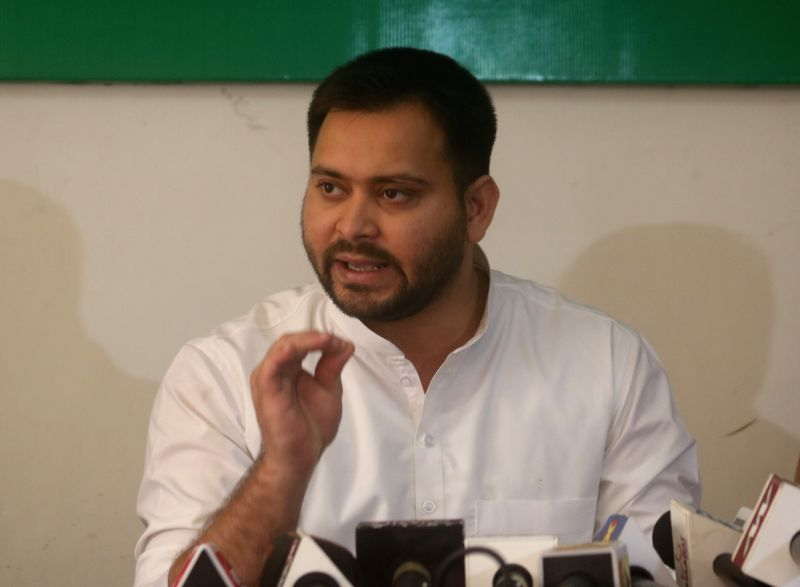 RJD leader Tejashwi Yadav addresses a press conference in New Delhi on Aug. 11, 2018. - Tejashwi Yadav