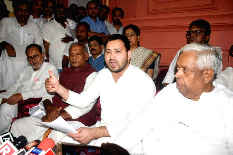RJD leader Tejashwi Yadav addresses the media along with HAM chief Jitan Ram Manjhi after visiting the Muzaffarpur Balika Shelter home, on July 25, 2018.The Patna High Court on Wednesday ... - Tejashwi Yadav