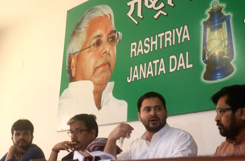 RJD leader Tejashwi Yadav addressing a press conference in New Delhi on Aug. 11, 2018. - Tejashwi Yadav