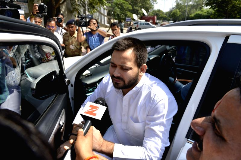 RJD leader Tejashwi Yadav arrives to appear before CBI in connection with the ongoing probe into the 2006 IRCTC hotel case at CBI Headquarters in New Delhi, on Oct 6, 2017. - Tejashwi Yadav