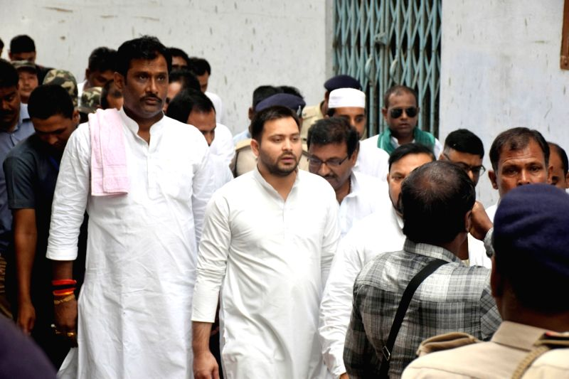 RJD leader Tejashwi Yadav during his visit to the Muzaffarpur Balika Shelter home, on July 25, 2018. The Patna High Court on Wednesday took suo motu cognisance of the rape of over 20 ... - Tejashwi Yadav