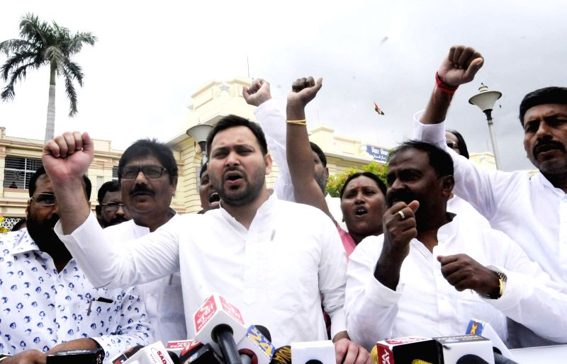 RJD leader Tejashwi Yadav talks to the media outside the Bihar Legislative Assembly, in Patna on July 25, 2018. - Tejashwi Yadav