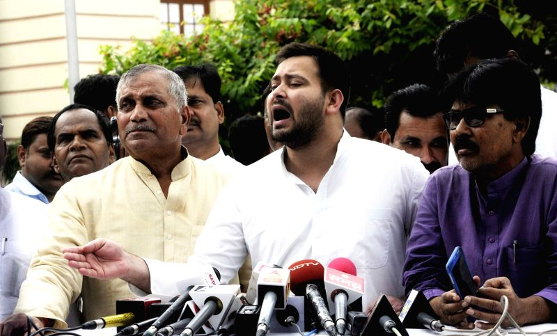 RJD leader Tejashwi Yadav talks to the media outside the Bihar Legislative Assembly, in Patna on July 26, 2018. - Tejashwi Yadav