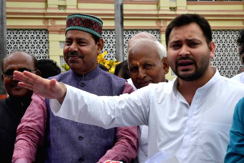 RJD leader Tejaswi Yadav talks to the media outside Bihar Legislative Assembly, in Patna on July 24, 2018. - Tejaswi Yadav