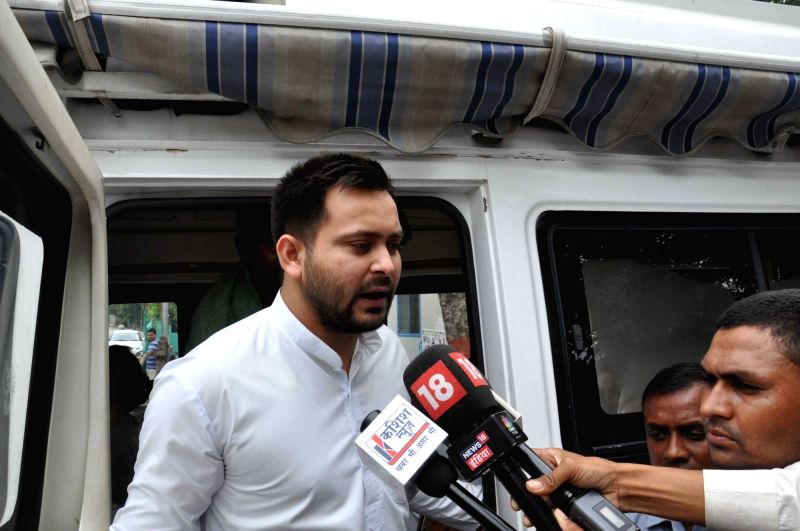 RJD leader Tejaswi Yadav talks to the press, in Patna, on July 26, 2018. - Tejaswi Yadav